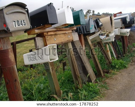 Row of old mail boxes in countryside. - stock photo