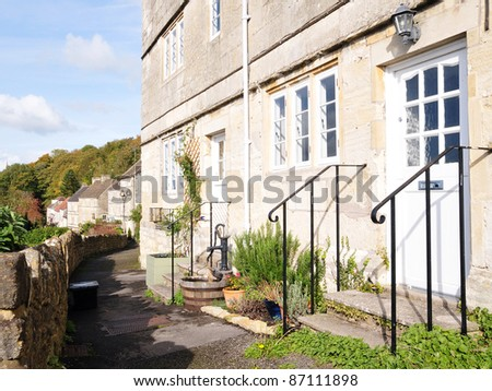 Row of Old Stone Cottages in Rural England - stock photo