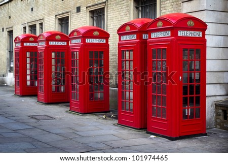Row of old style UK red phone boxes in Covent Garden, London