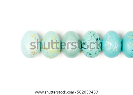 Row of ombre blue  Easter eggs isolated on white background