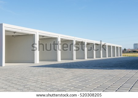 row of open and empty garages