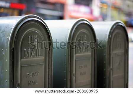 Row of outdoors mailboxes in NY, USA - stock photo