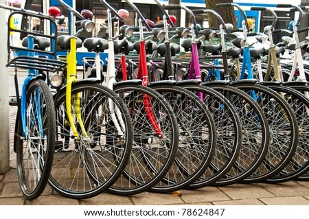 Row of parked colorful bicycles - stock photo