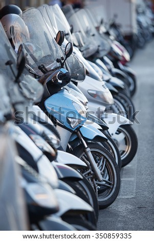 Row of parked Motor Scooters on the streets of Florence, Italy - stock photo