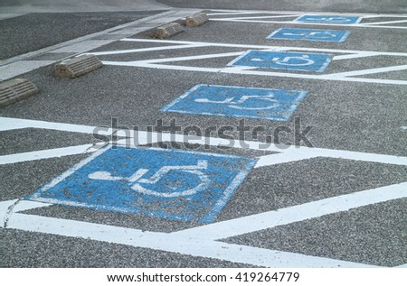 row of parking cripple, disabled parking sign