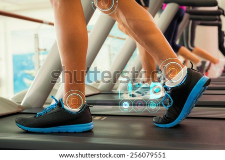 Row of people working out on treadmills against fitness interface - stock photo