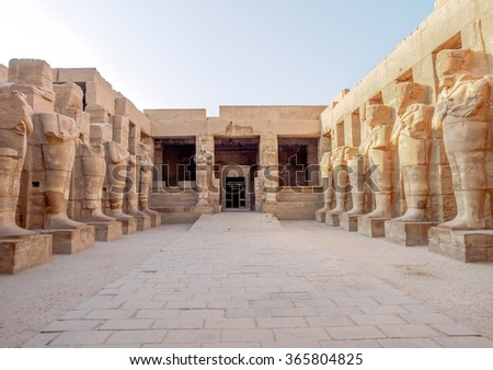 Row of Pharaohs statues in The temple of Karnak in Luxor Egypt - stock photo