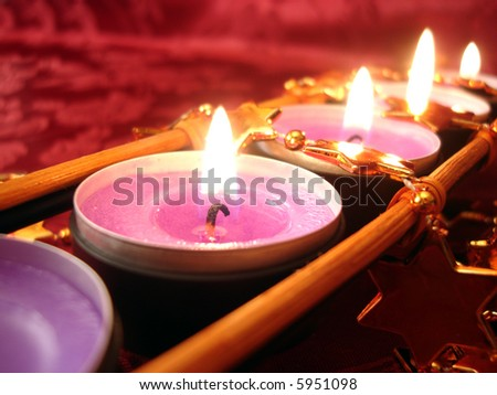row of pink candles with stars, close-up - stock photo