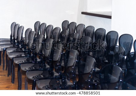 Row of plastic black chairs