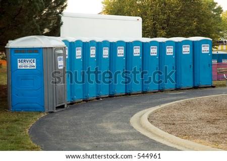 Row of portable toilets - stock photo