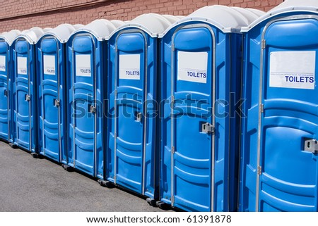 row of portable toilets - stock photo