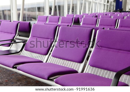 row of purple chair at airport - stock photo