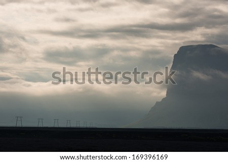 Row of Pylons at the Misty South Coast of Iceland - stock photo