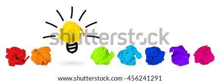 row of rainbow colored paper balls with idea light bulb symbol - stock photo