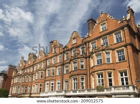 Row of red brick apartments in Mayfair, London, UK - stock photo