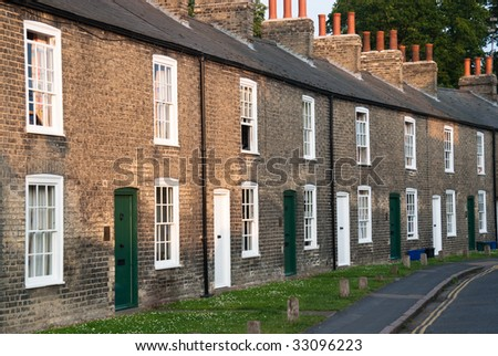 Row of red brick terraced houses - stock photo