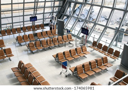 Row of red chair at airport. - stock photo