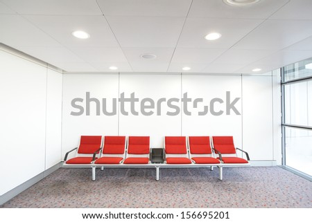 row of red chair at airport, shot in asia, hong kong - stock photo