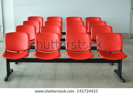 Row of red chair in the waiting room railway station, Thailand. - stock photo