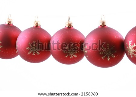 row of red Christmas balls isolated on white