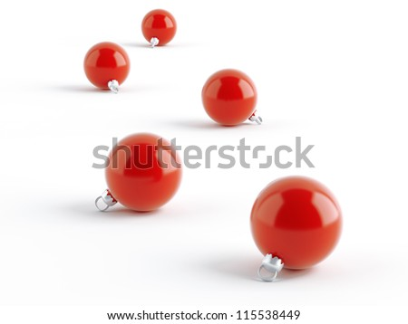 row of red Christmas balls on white background