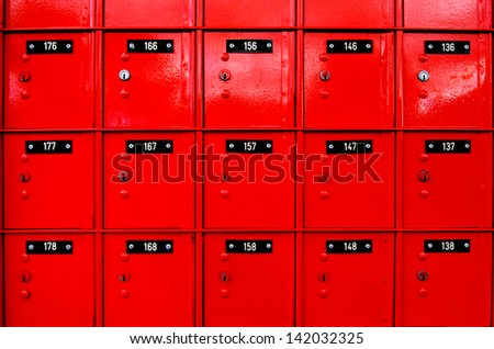 Row of red post-office boxes. - stock photo