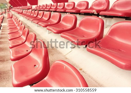 row of red seat in football stadium