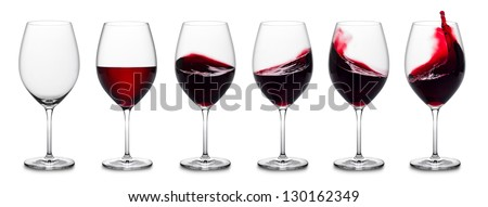 row of red wine glass full empty and with splashes. - stock photo