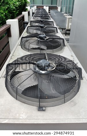 Row of Residential air conditioner compressor units in The Garden - stock photo