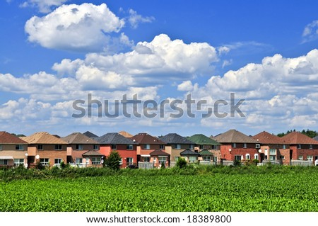 Row of residential houses in suburban neighborhood - stock photo