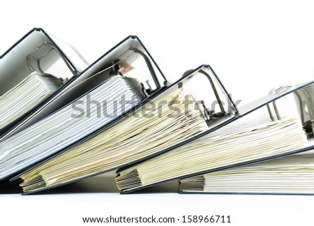 Row of ring binders with documents and paperwork - stock photo