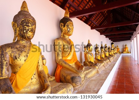 Row of Sacred Buddha images in - stock photo