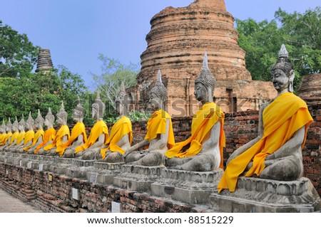 Row of Sacred Buddha images in Ayutthaya, Thailand - stock photo