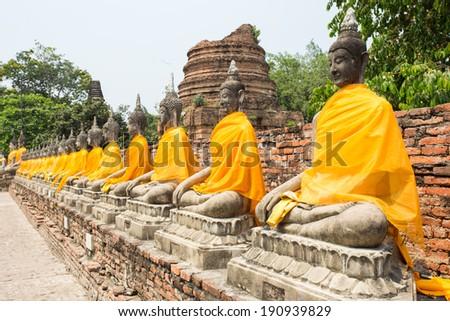 Row of Sacred Buddhas at Wat Yaichaimongkol, Ayutthaya, Thailand - stock photo