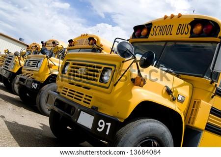 Row of School Buses - stock photo