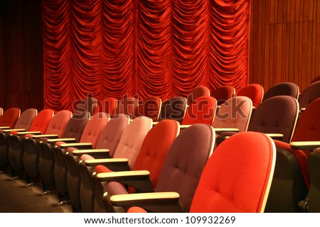 Row of seats in an empty theater - stock photo