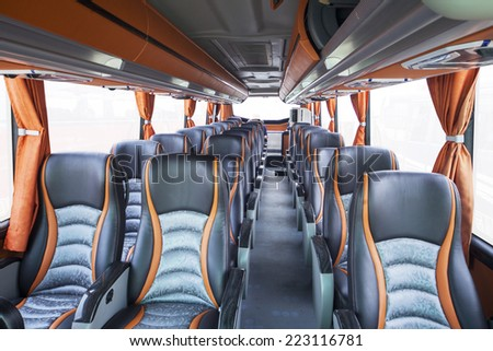 Row of seats inside tourist bus, shot in exhibition - stock photo