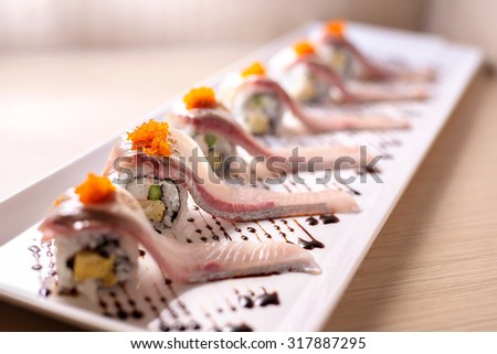 Row of Selective focus of Hamachi sushi roll - Japanese food - stock photo