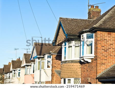 Row of semi-detached suburban houses in the UK with retrom filter applied - stock photo
