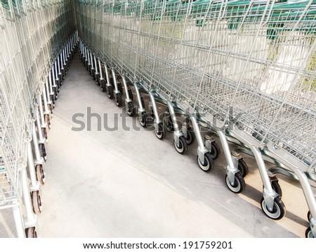 Row of shopping carts at supermarket - stock photo