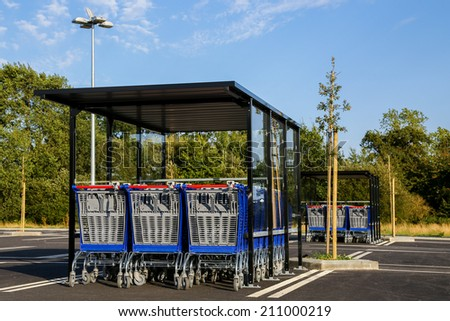 row of shopping trolleys on empty supermarket - stock photo