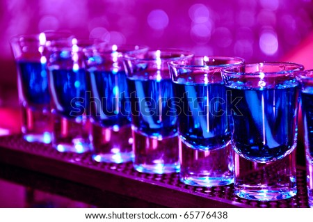 Row of shots on the counter, first is sharp and then they are blurried away - stock photo