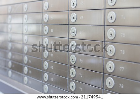 row of silver safes - stock photo