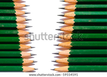 Row of single colored pencils isolated on white background - stock photo