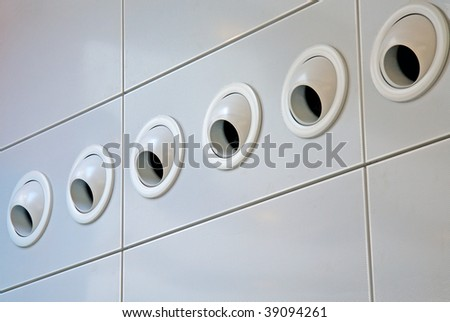 row of six air conditioning vents - stock photo