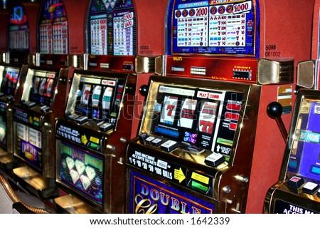 Row of slot machines - stock photo