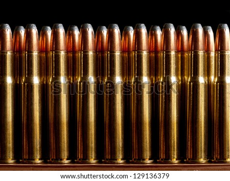 Row of soft tip bullets. - stock photo