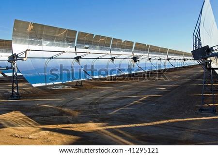 Row of solar panels in the bright desert sun. - stock photo