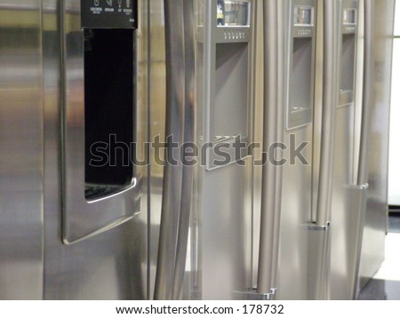 Row of stainless steel refrigerators - stock photo