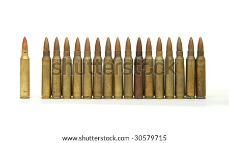 Row of standing 5.56mm M16 assault rifle cartridges isolated - stock photo